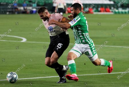 Betis' Nabil Fekir (R) in action against Espanyol's David Lopez (L) during the Spanish La Liga soccer match between Real Betis and RCD Espanyol at Benito Villamarin stadium in Seville, southern Spain, 25 June 2020.