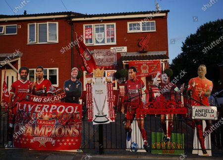 Lifesize cardboard cutouts of Liverpool FC manager Juergen Klopp (3-L) and several of the team's players decorate a fence outside a house in Liverpool, Britain, 25 June 2020. Liverpool could be crowned champions of the Premier League for the first time in three decades in the event that Manchester City FC were to fail to beat Chelsea FC in their ongoing duel. If City draw or lose, it would mathematically hand the English top league title to the Liverpudlian club tonight.