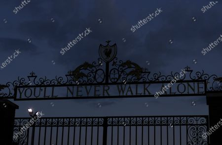 Liverpool's slogan 'You'll Never Walk Alone' tops a wrought-iron gate at Anfield stadium as dusk settles over Liverpool, Britain, 25 June 2020. Liverpool FC could be crowned champions of the Premier League for the first time in three decades in the event that Manchester City FC were to fail to beat Chelsea FC in their ongoing duel. If City draw or lose, it would mathematically hand the English top league title to the Liverpudlian club tonight.