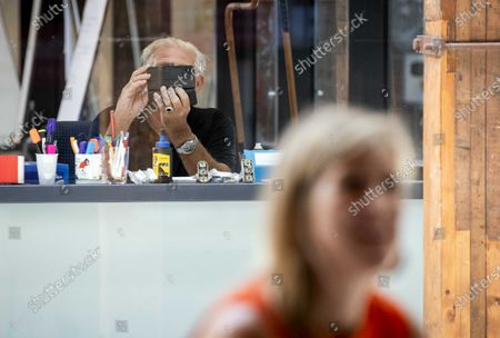 A man takes a picture of Dutch Queen Maxima during her working visit to the TechnoHub in Woerden, The Netherlands, 25 June 2020. During the visit, the importance of well-trained technical personnel for SMEs and the impact of the Covid-19 coronavirus crisis was discussed.