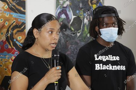 Naudia Miller, left, and Marcus Henderson, right, both of Black Collective Voices, speak, at a news conference in Seattle. Miller said the goal of protesters who have been active in the CHOP (Capitol Hill Occupied Protest) zone and elsewhere in the city since the death of George Floyd in Minneapolis is to dismantle systemic racism and to continue organizing until all of their demands are met