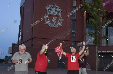 Ecstatic Liverpool FC supporters celebrate next to Anfield stadium in Liverpool, Britain, 25 June 2020. Liverpool have been crowned champions of the Premier League for the first time in three decades after Chelsea FC beat Manchester City FC 2-1. Man City's failure to win this crucial duel mathematically handed the English top league title to the Liverpudlian club led by German manager Juergen Klopp.