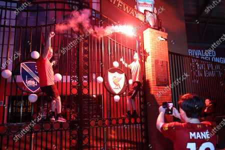 Liverpool fans outside Anfield celebrate winning the Premier League for the first time in 30 years after Chelsea beat Manchester City tonight ensuring Liverpool can no longer be overtaken on points.