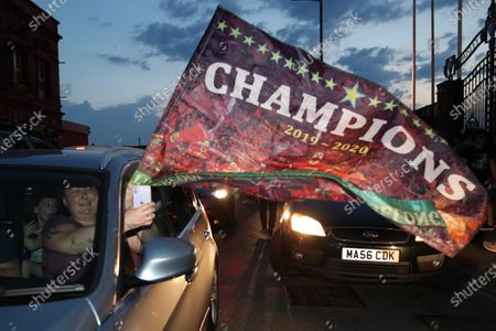 Liverpool fans in cars outside Anfield celebrate winning the Premier League for the first time in 30 years after Chelsea beat Manchester City tonight ensuring Liverpool can no longer be overtaken on points.