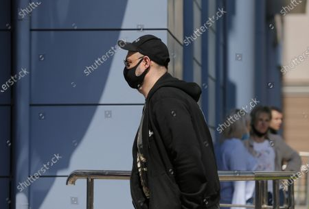 Russian film and theater director Kirill Serebrennikov wearing a protective face mask arrives for a court hearing at the Meshchansky court in Moscow, Russia, . A court in Moscow is expected to deliver a verdict on Friday to the acclaimed theater director accused of embezzling state funds, in a case widely seen as politically motivated