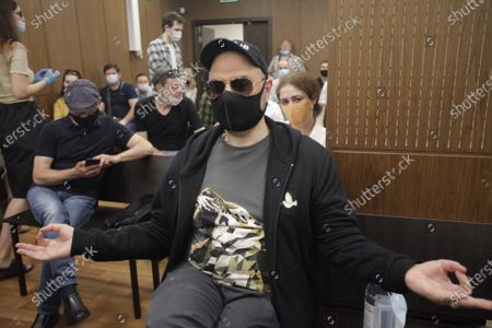 Russian film and theater director Kirill Serebrennikov wearing a protective face mask sits prior to a court hearing at the Meshchansky court in Moscow, Russia, . A court in Moscow is expected to deliver a verdict on Friday to the acclaimed theater director accused of embezzling state funds, in a case widely seen as politically motivated