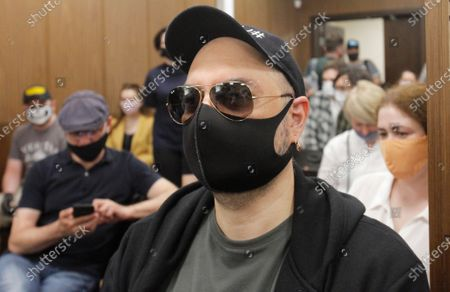 Russian film and theater director Kirill Serebrennikov wearing a protective face mask sits prior to his court hearing at the Meshchansky court in Moscow, Russia, . A court in Moscow is expected to deliver a verdict on Friday to the acclaimed theater director accused of embezzling state funds, in a case widely seen as politically motivated