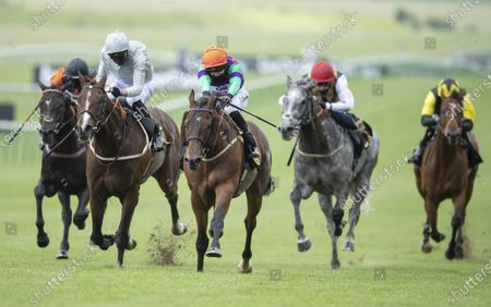Arigato (Josephine Gordon,orange cap) beats Blown By Wind (James Doyle, left) in the Heed Your Hunch At Betway Handicap StakesNewmarket 27.6.20 Pic: Edward Whitaker/ Racing Post, supplied by Hugh Routledge.