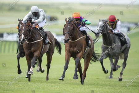 Arigato (Josephine Gordon,centre) beats Blown By Wind (James Doyle, left) in the Heed Your Hunch At Betway Handicap StakesNewmarket 27.6.20 Pic: Edward Whitaker/ Racing Post, supplied by Hugh Routledge.