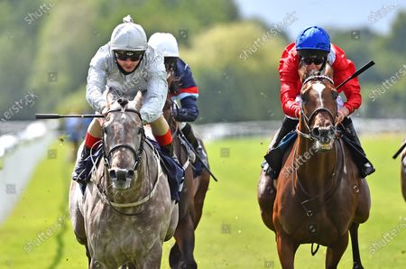 "Stock Photo of (L) Overwrite (Andrea Atzeni) wins The Bombardier ""March To Your Own Drum"" Handicap Stakes from (R) Tell Me All (Luke Morris)."