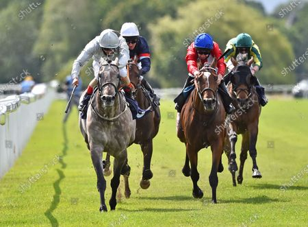 "Stock Picture of (L) Overwrite (Andrea Atzeni) wins The Bombardier ""March To Your Own Drum"" Handicap Stakes from (R) Tell Me All (Luke Morris)."