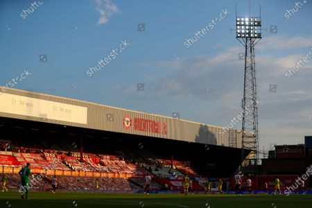 General View of match, empty stands, supporters' flags, blue sky and floodlights