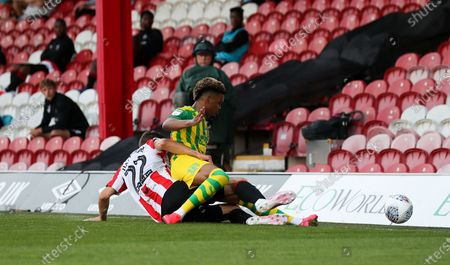 Henrik Dalsgaard of Brentford tackles Grady Diangana of West Bromwich Albion