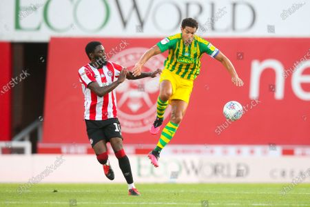 Jake Livermore of West Bromwich Albion beats Josh Dasilva of Brentford to the ball