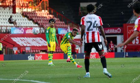 Grady Diangana of West Bromwich Albion takes a freekick - Tariqe Fosu of Brentford (R)
