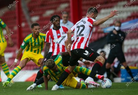 Grady Diangana of West Bromwich Albion battles on the floor with Henrik Dalsgaard of Brentford