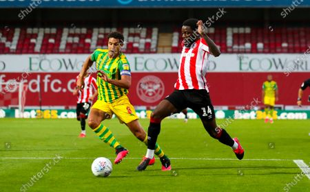 Josh Dasilva of Brentford breaks into the box after a commanding run - Jake Livermore of West Bromwich Albion tracks back