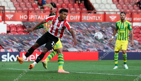 Ollie Watkins of Brentford challenges for the ball in the area - Ahmed Hegazi of West Bromwich Albion behind