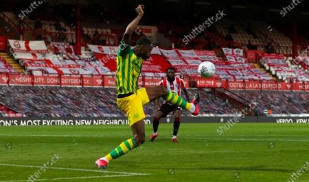 Semi Ajayi of West Bromwich Albion stretches for a ball which ends up at Josh Dasilva of Brentford's  (behind) feet but he squanders the chance