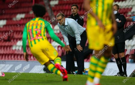 West Bromwich Albion Manager Slaven Bilic   bends over with his hands on his knees - looks frustrated