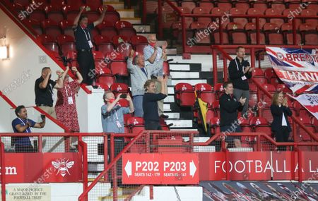 The few people allowed in the ground celebrate Brentford's victory