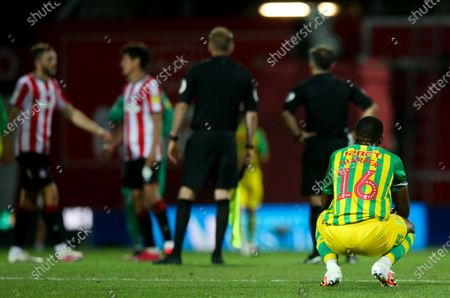 Dejected Rekeem Harper of West Bromwich Albion crouches down after the final whistle is blown