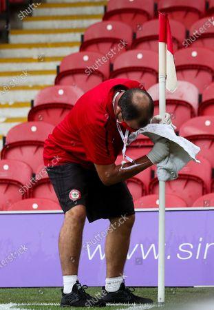 'Jonny' cleans the posts, balls & corner flags during the Coronavirus pandemic