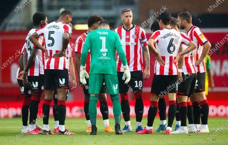 Pontus Jansson of Brentford (18) gives his pre-match  team talk