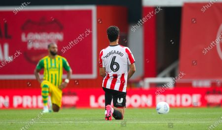 Christian Norgaard of Brentford takes a knee before the match