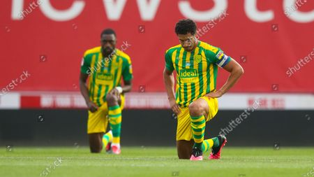 Jake Livermore of West Bromwich Albion (R) takes a knee before the match