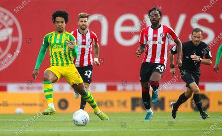 Matheus Pereira of West Bromwich Albion & Tariqe Fosu of Brentford (R)