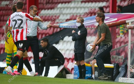 Brentford Manager Thomas Frank throws the ball back to Henrik Dalsgaard of Brentford
