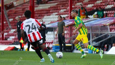 Kieran Gibbs of West Bromwich Albion & Tariqe Fosu of Brentford