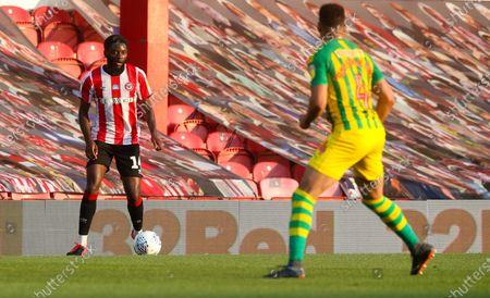 Josh Dasilva of Brentford & Hal Robson-Kanu of West Bromwich Albion