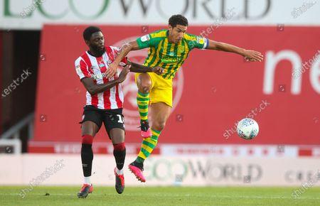 Josh Dasilva of Brentford & Jake Livermore of West Bromwich Albion (R)