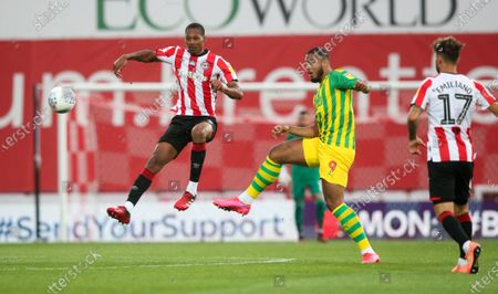 Ethan Pinnock of Brentford & Kenneth Zohore of West Bromwich Albion