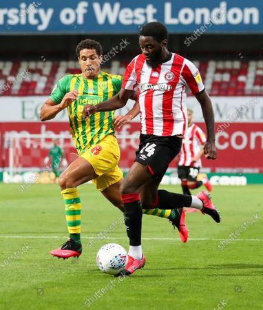 Josh Dasilva of Brentford attacks Jake Livermore of West Bromwich Albion