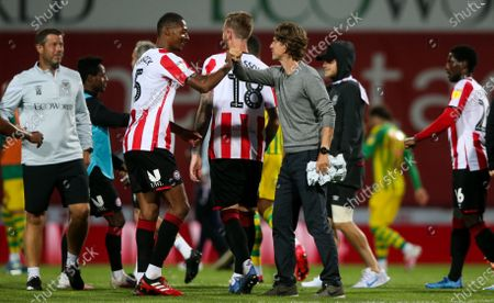 Stock Picture of Brentford Manager Thomas Frank & Ethan Pinnock of Brentford celebrate victory with an elbow bump