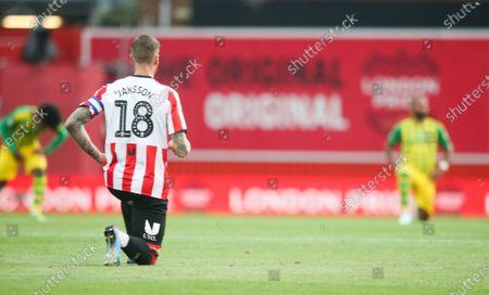 Pontus Jansson of Brentford takes a knee before kick off