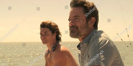Stock Photo of Chase Stokes as John B and Charles Esten as Ward Cameron
