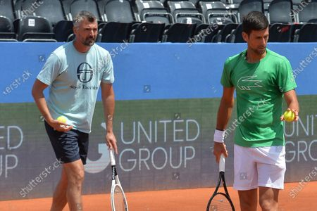 Former Wimbledon champion Goran Ivanisevic, left, who now coaches top-ranked Novak Djokovic, right, attends a training session during an exhibition tournament in Zadar, Croatia. The Croatian great, who won his only Grand Slam title at the All England Club in 2001, wrote on Instagram that he tested positive for coronavirus after two negative tests in the last 10 days