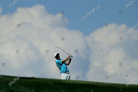 Russell Henley tees off on the 14th hole during the second round of the Travelers Championship golf tournament at TPC River Highlands, in Cromwell, Conn