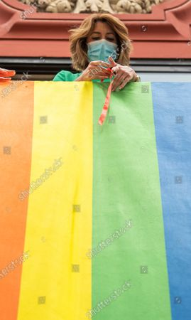 Leader of Andalucia's Socialist Party, Susana Diaz, places a rainbow flag at the party's headquarters in Seville, Spain, on occassion of the Gay Pride 2020 celebrations, 26 June 2020.