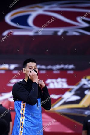 Jeremy Lin of Beijing Ducks reacts prior to a match between Zhejiang Lions and Beijing Ducks at the newly resumed 2019-2020 Chinese Basketball Association (CBA) league in Qingdao, east China's Shandong Province, June 26, 2020.