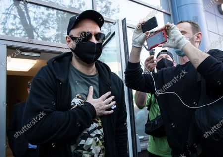 Russian film and theater director Kirill Serebrennikov, wearing a face mask to protect against coronavirus, leaves the Meshchansky court after hearings in Moscow, Russia