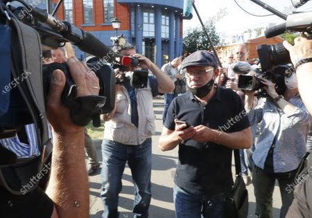 Stock Image of Producer of Studio Seven Alexei Malobrodsky surrounded by TV journalists speaks outside Moscow's Meschansky district court, Russia, 26 June 2020. Moscow avant-garde theater Gogol Center artistic director Kirill Serebrennikov and other defendants in the so-called Studio Seven case are accused on being involved in the alleged embezzlement of state art funds allocated between 2011 and 2014 for the theatrical project Platforma. The prosecutor demanded for Serebrennikov six years in prison.