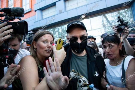 Russian film and theater director Kirill Serebrennikov, wearing a face mask to protect against coronavirus to protect against coronavirus, greets his supporters and colleagues as he leaves the Meshchansky court after hearings in Moscow, Russia, . A Moscow judge has convicted an acclaimed Russian theater director of embezzling state funds and imposed a three-year suspended sentence in a case widely seen as politically motivated. Kirill Serebrennikov and his associates were found guilty of fraud and embezzling 129 million rubles (over $1.8 million) of state funding for a theater project