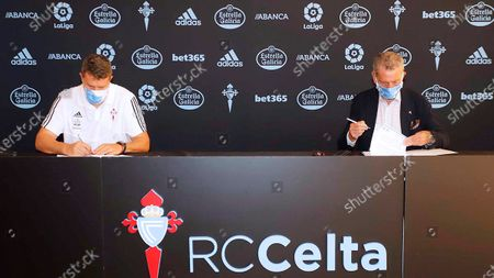 Head coach Oscar Garcia (L) sign a two year contract extension next to the President of RC Celta de Vigo, Carlos Mourino, in Vigo, Spain, 26 June 2020.