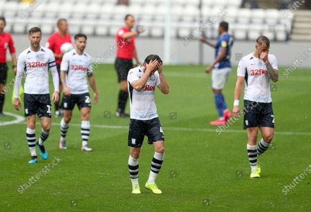 Ben Pearson of Preston North End looks dejected at full tome