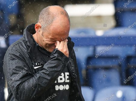 Alex Neil manager of Preston North End looks dejected at full time